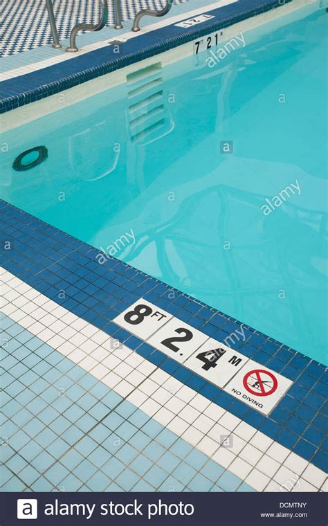swimming pool tiles give depth in and meters plus a