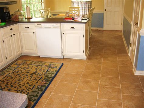 kitchen floor ideas with cabinets brown square tile kitchen floor plus rug combined with