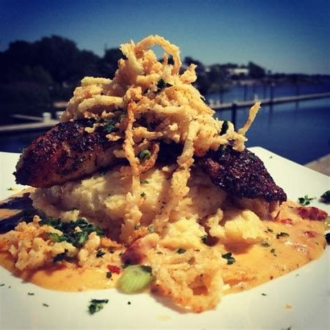 grouper blackened crawfish sauce cream leeks resting andouille grits gouda topped crispy smoked shrimp fried seafood lunchtime goodeats