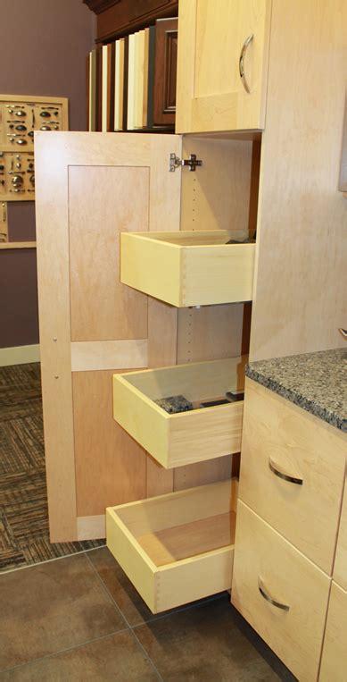 storage in the kitchen zeeland lumber supply showroom woodharbor pantry roll 5878
