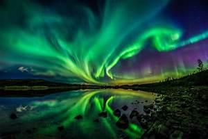 Northern Lights illuminate the night sky as sun unleashes ...