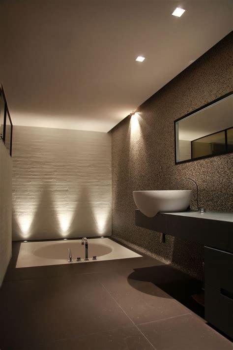 dramatic  lighting accents sculptural wall tiles villa