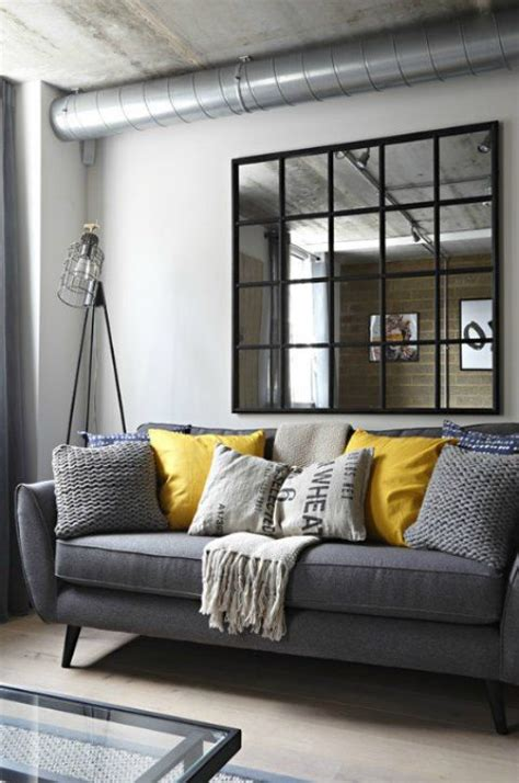 gray industrial living room   gray sofa  yellow