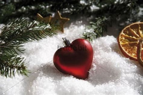 heart shaped christmas tree bauble branches of fir dried