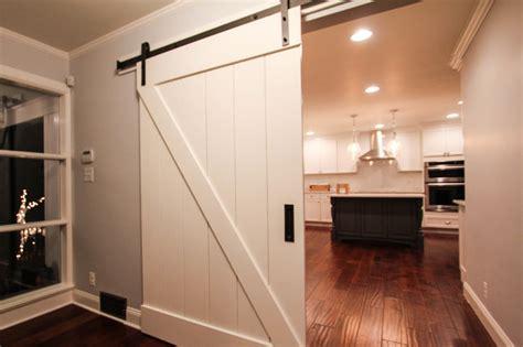 white wooden sliding barn door entering kitchen farmhouse kitchen philadelphia