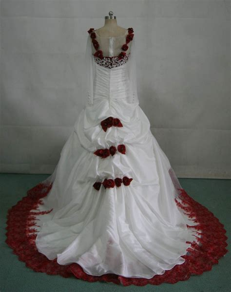 White Wedding Gown With Red Roses