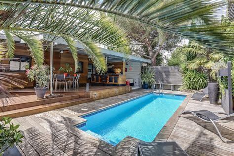cap cuisine lyon bègles maison en bois avec terrasse et piscine agence