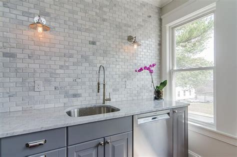 gray kitchen cabinets  gray marble mini subway tiles