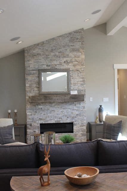stacked ledger stone gas fireplace  reclaimed barn