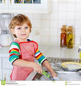 Funny Kid Boy Helping And Washing Dishes At Home Stock ...
