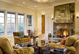 Stone fireplace and coffered ceiling create a cozy living