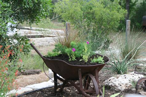 wheelbarrow planter ideas 20 great ideas for creative gardening using containers you