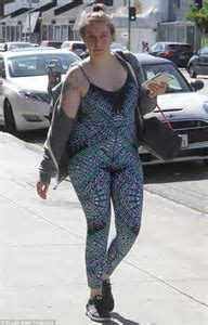Make up free Lena Dunham bumps into Parker Posey in