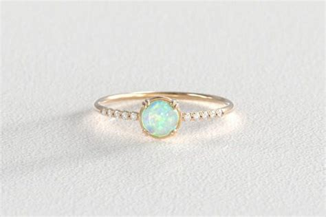 16 Opal Engagement Rings You'll Fall In Love With  Brit + Co. Horizontal Rings. Hammered Finish Wedding Rings. Cluster Wedding Rings. Modern Marriage Wedding Rings. Unique Classic Engagement Engagement Rings. Obscure Engagement Rings. Ten Year Anniversary Wedding Rings. Geek Wedding Rings