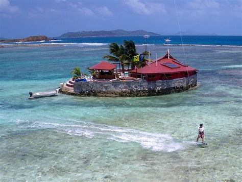 happy island grenadines beach bars caribbean