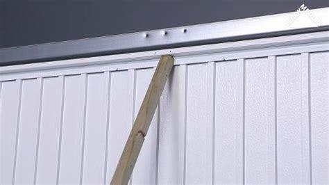 comment poser une porte de garage basculante leroy merlin