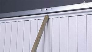 comment poser une porte de garage basculante leroy merlin With porte de garage basculante pour changer une porte d entrée