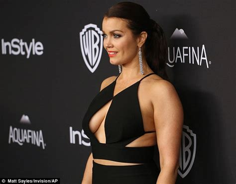 bellamy young shows bellamy young shows cleavage in a cut out gown at golden