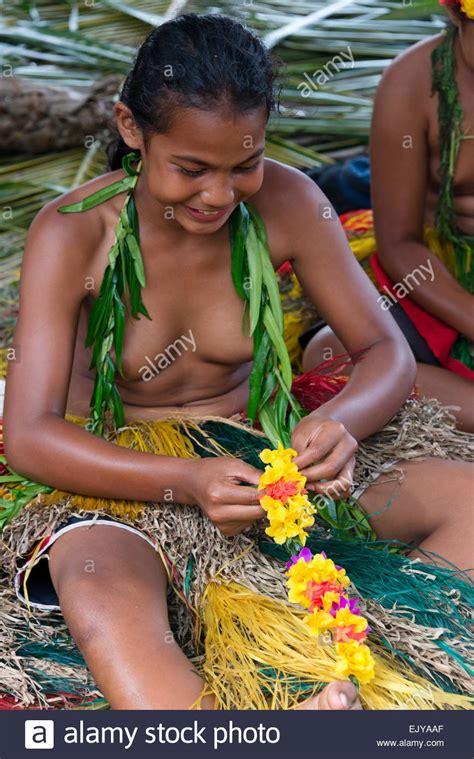Yapese girls making flower lei for Yap Day Festival, Yap