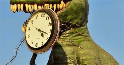 Funny Jokes 'n' Pictures : Dinosaur Eating Clocks Time
