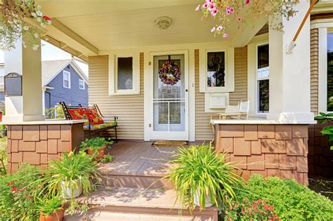 cozy covered porch  white columns  american craftsman house stock photo  image