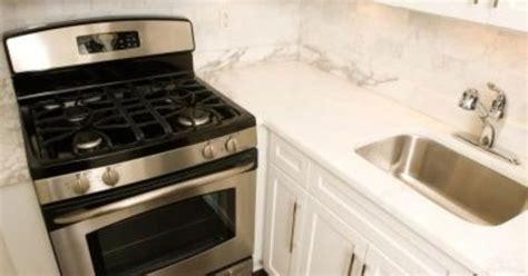 cleaning kitchen cabinets with vinegar and baking soda how to clean an oven with white vinegar baking soda