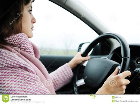 Sad Young Woman Driving Car In Rain Stock Images
