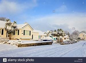 Snow scene on a suburban street and houses after heavy ...
