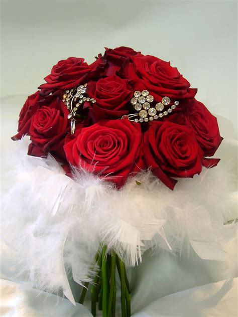 red rose brooch bouquet  feathers wedding pinterest