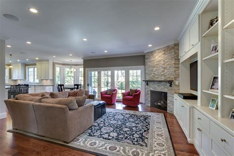 stone corner fireplace Family Room Traditional with built ins corner Fireplace stone