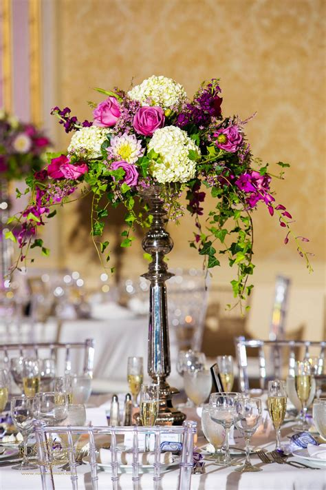 Tall Vase Of White Purple And Green Flowers For A Wedding