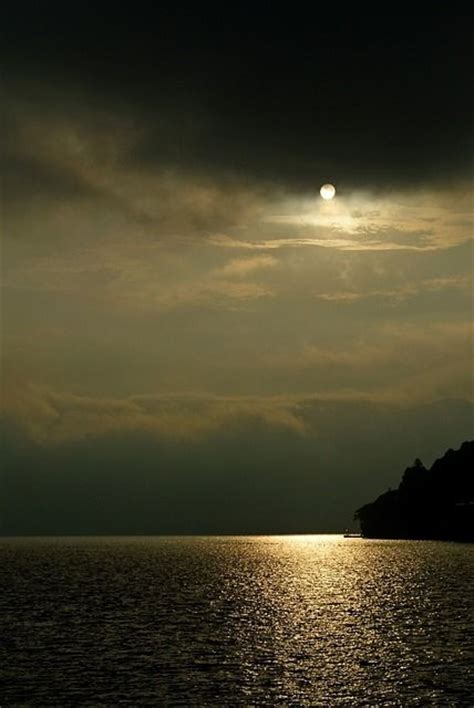 sun  dark clouds pictures   images