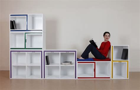 modular bookcase with tables and chairs as if