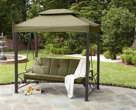 black metal patio swing with grey fabric canopy and grey