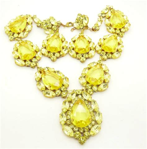 non matching drop earrings yellow glass statement necklace and matching