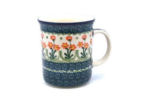 Deneen pottery footed mug came off the line in 1996 and has remained a customer favorite ever since. Polish Pottery Mug - Big Straight Sided - Peach Spring Daisy B13-560a