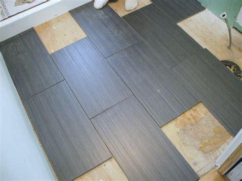 laying tile on wood floor laying a tile floor in a bathroom wood floors zyouhoukan