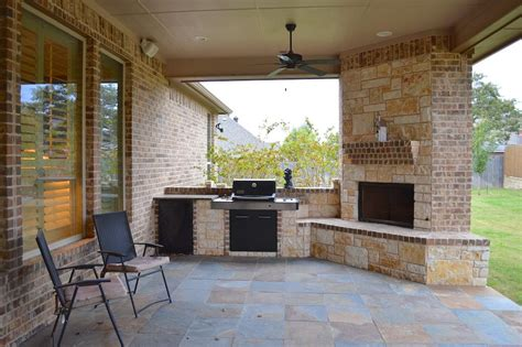 outdoor gas fireplace and grill