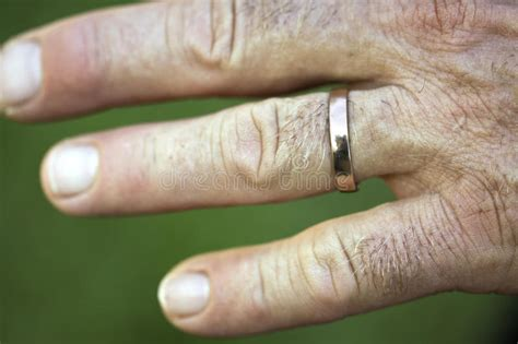 closeup of a wedding ring on a man s hand royalty free