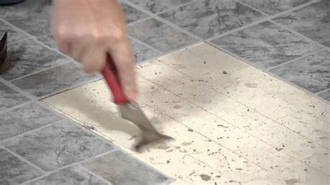 remove vinyl tiles adhesive  wood flooring