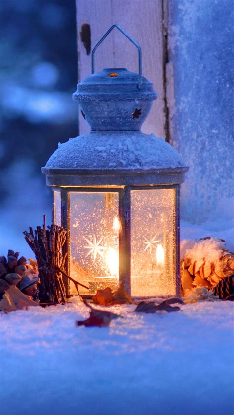 And also it will fit for major resolutions. Lantern Snow Winter Christmas Eve 4K Ultra HD Mobile Wallpaper