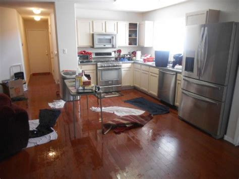 flooded kitchen floor flooded kitchen water damaged wood flooring 3782