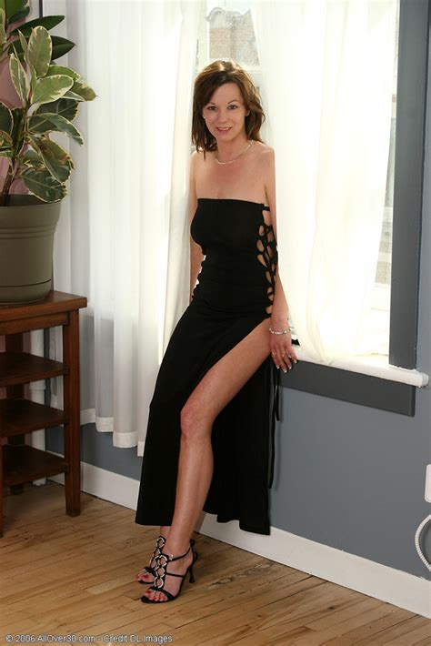 Elegant Mature Brunette In Long Evening Gown With Long