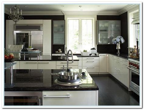 kitchen with black countertops and white cabinets white cabinets countertops details home and cabinet 9849