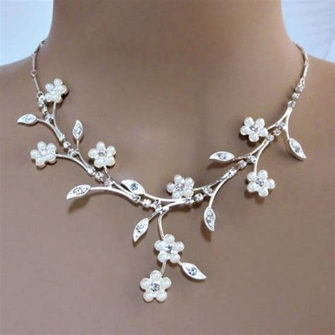 faux pearl white flowers adorn elaborate rhinestone