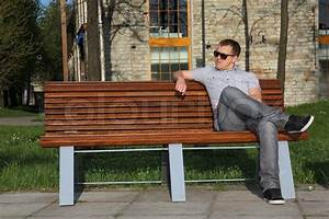 Man sitting in park on the bench | Stock Photo | Colourbox