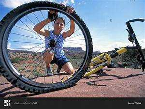 Woman Fixing Flat Tire On Her Mountain Bike While Riding