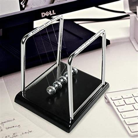 swinging balls on desk newton 39 s cradle swinging balance balls science gift