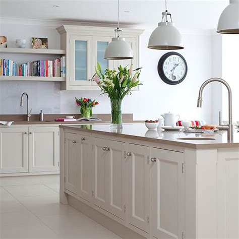 pale grey kitchen with oak effect floor traditional