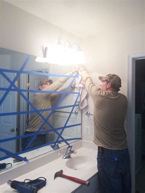 How To Remove A Bathroom Mirror Glued To The Wall how to safely remove that large builder bathroom mirror